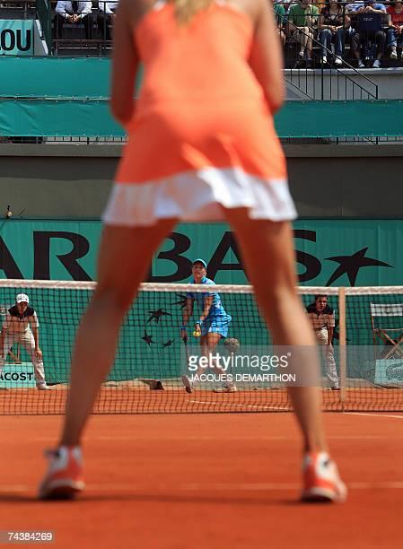 Italian player Tathiana Garbin serves to Czech player Nicole Vaidisova during their French Tennis Open fourth round match at Roland Garros, 03 June...