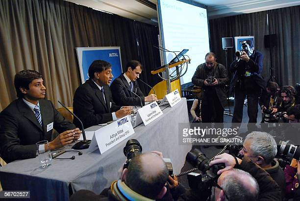 Lakshmi Mittal the head of Mittal Steel who has launched a hostile takeover bid for European rival Arcelor smiles next to his son Aditya Mittal...