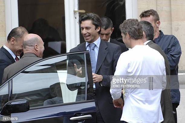 Laurent Solly advisor of French Presidentelect Nicolas Sarkozy speaks several unidentified persons in front of Sarkozy's temporary office 11 May 2007...