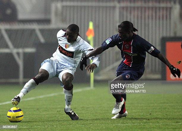 Lens' forward Aruna Dindane from Ivory Coast vies with Paris SaintGermain's defender Bernard Mendy during their French L1 football match 27 November...