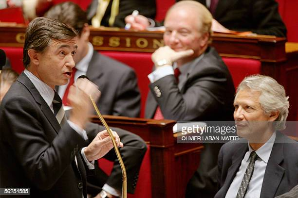 Minister of Foreign Affairs Philippe DousteBlazy speaks in front of Prime Minister Dominique de Villepin listen the debates 22 November 2005 during a...