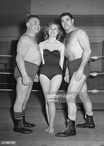 Miss France Meets A Wrestling DuoThe newly elected Miss France Maryse Delort is shown with wrestlers Sexton and Henri Declane at their training camp...