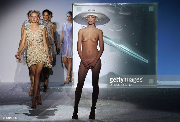 Models present creations by Britishbased Turkish Cypriot designer Hussein Chalayan during the Spring/Summer 2007 readytowear collections in Paris 04...