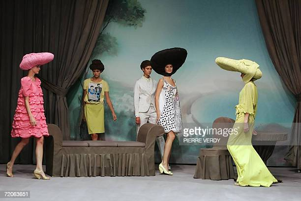 Models present creations by Russian designer Alena Akhmadullina during the Spring/Summer 2007 readytowear collections in Paris 02 October 2006 AFP...