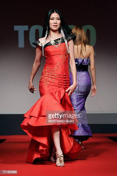 Models present creations of Mongolian designer Torgo during a couture runway as part of the 3rd edition of the Paris' Ethical Fashion Show 13 October...