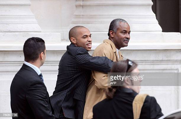 NBA superstar Tony Parker's father jokes with French football international player Thierry Henry as they arrive to attend the Desesperate Housewives...