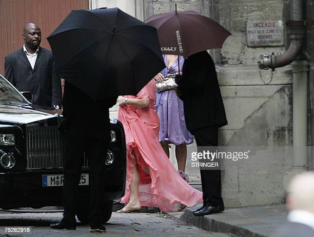 NBA superstar Tony Parker's mother Pamela Firestone is hidden by umbrellas as she leaves the SaintGermain l'Auxerrois church after attending the...