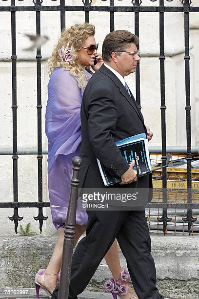 NBA superstar Tony Parker's mother Pamela Firestone arrives with an unidentified person at SaintGermain l'Auxerrois church to attend the wedding...