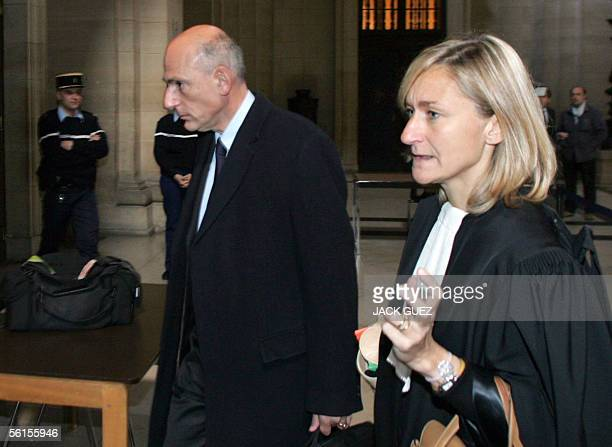 Olivier Lambert legal director of French defence firm Thomson arrives in Paris tribunal 14 November 2005 before the beginning of the trial of Thomson...