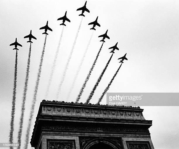 "Paris, France on July 14, 1996 - Military parade in Paris on July 14th. The ""Patrouille de France flies over the"" Arc de Triomphe."