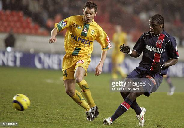 Paris' defender Bernard Mendy vies with Nantes' Olivier Quint during their French L1 football match 05 March 2005 at the Parc des Prince stadium in...