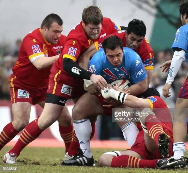 Paris Prop Yohan Montes breaks away from Perpignan players prop Nicolas Mas, prop Vincent Debaty and flanker Viliani Vaki during their French Top 14...
