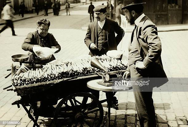 Parisian street scene Asparagus seller's sales talk is recorded on a grammaphone Undated photograph