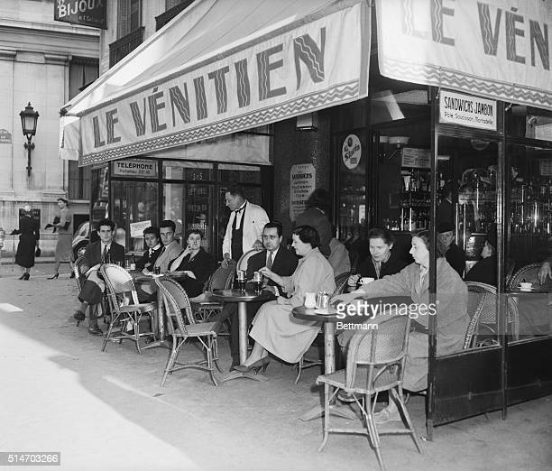 1/1/1954 Paris France Parisians enjoy their coffee at the colorful sidewalks cafes of the city Photo shows typical Parisians enjoying a coffee break