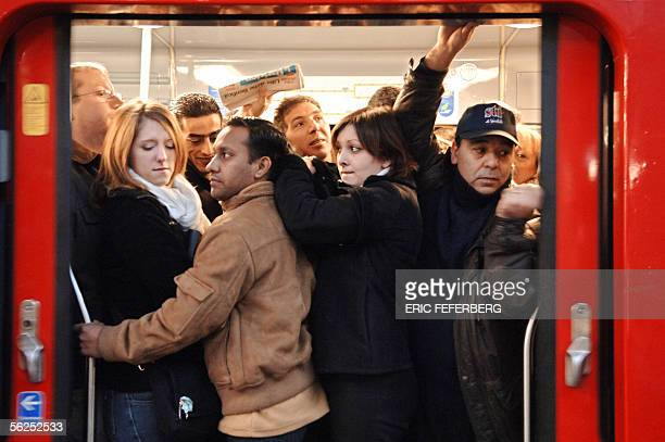 People try to board an overcrowded train at the Gare Saint Lazare railway station 22 November 2005 in Paris as the majority of trains in France...