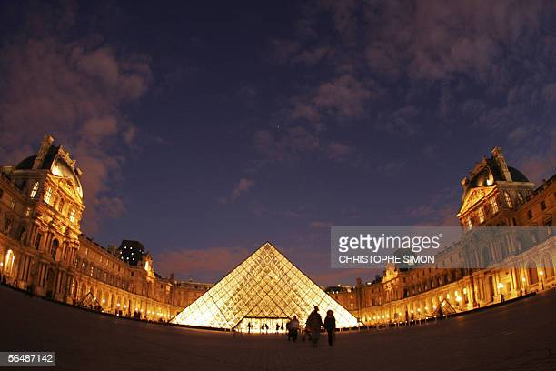 Picture taken 25 December 2005 of the Louvre Pyramid illuminated on christmas evening, 25 December 2005 in Paris. AFP PHOTO CHRISTOPHE SIMON