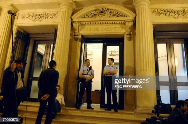 Policemen stand guard 05 October 2006 in Paris as the French Court of Revision which reopens a 83 yearold mystery considering a request to quash the...