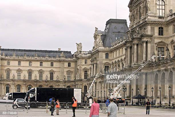 Production trucks are pictured 30 June 2005 at the Louvre museum in Paris on the first day of the filming of the movie 'The Da Vinci code' directed...