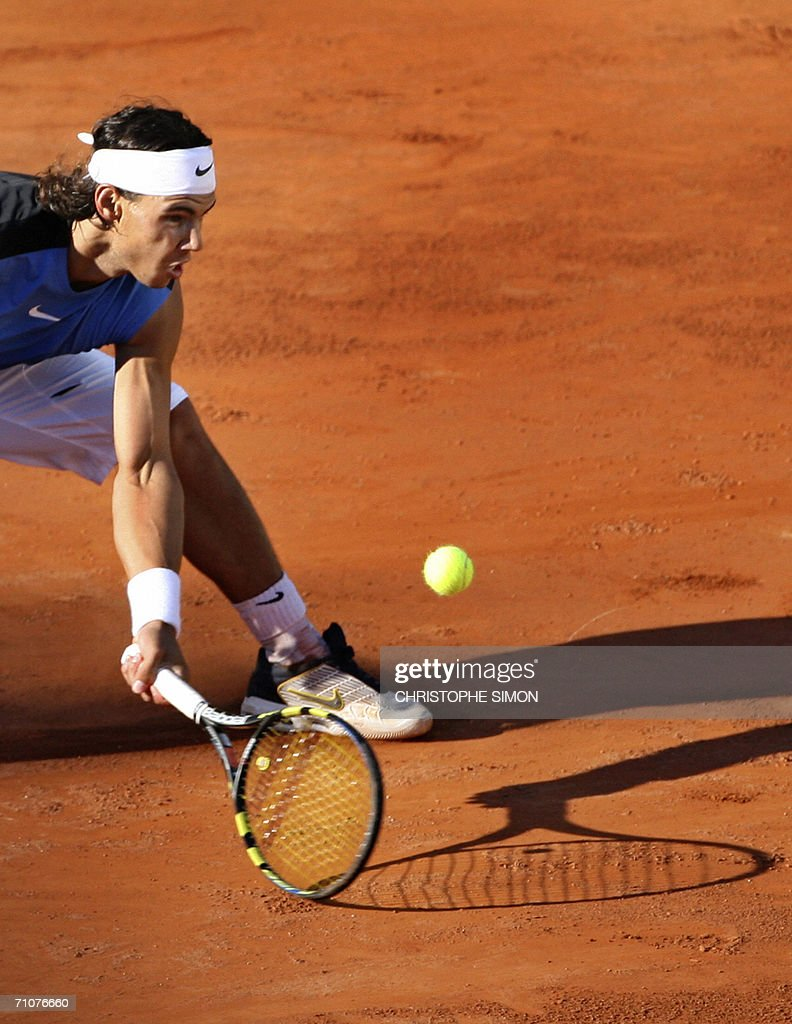Rafael Nadal of Spain hits a return to Swedish Robin Soderling during the first round of the French Tennis Open at Roland Garros in Paris 29 May 2006.