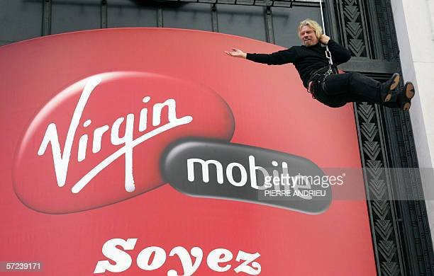 Richard Branson decends an abseil rope 03 April 2006 in Paris prior to a press conference for the launch of Virgin Mobile in Frence Virgin Mobile...