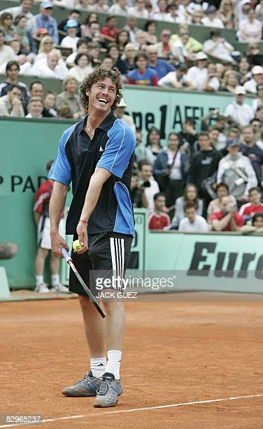 Russian Marat Safin prepares to serve during his friendly double tennis match with French Gilles Simon against German Steffi Graf and Belgium Justine...
