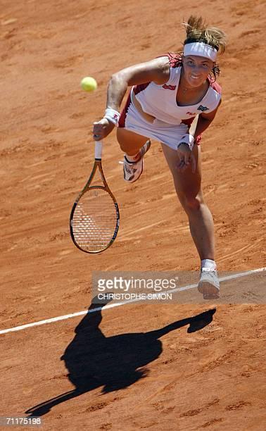 Russian Svetlana Kuznetsova hits a shot to Belgian Justine HeninHardenne during the French tennis Open final at Roland Garros in Paris 10 June 2006...