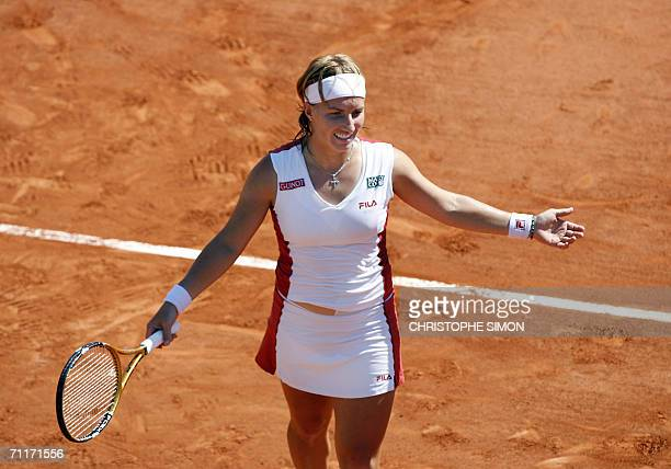 Russian Svetlana Kuznetsova reacts during her match against Belgian Justine HeninHardenne during the French tennis Open finals at Roland Garros in...