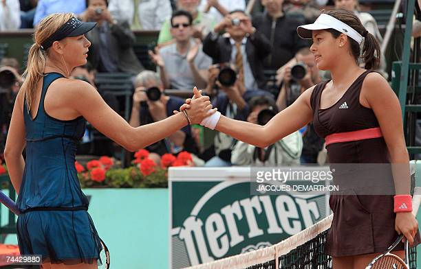 Serbian player Ana Ivanovic shakes hands with Russian player Maria Sharapova during their French Tennis Open semi final match at Roland Garros 07...