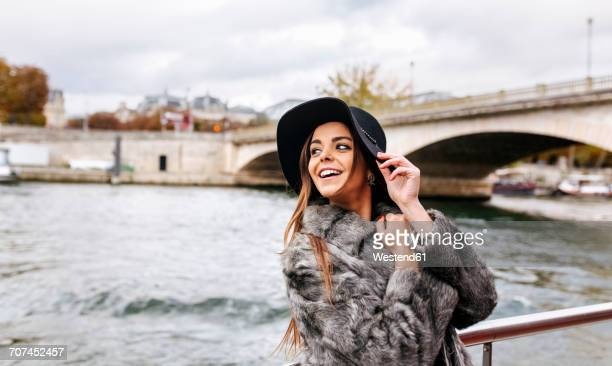 paris, france, smiling woman taking a cruise on seine river - tourboat stock pictures, royalty-free photos & images