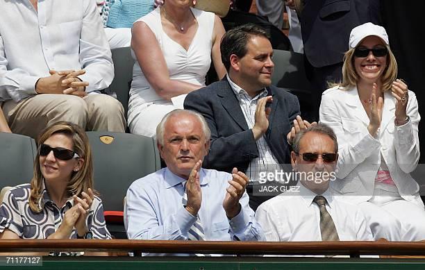 Spain's Princess Cristina President of the French Tennis Federation Christian Bimes and Paris' mayor Bertrand Delanoe watch the match opposing...