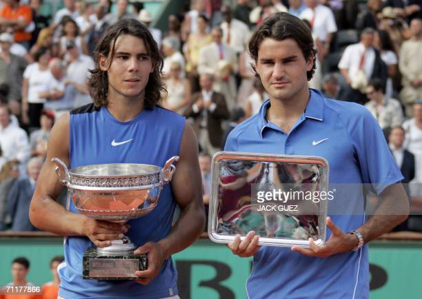 Spain's Rafael Nadal and Swiss Roger Federer pose on the podium after the French tennis Open finals at Roland Garros in Paris 11 June 2006 Nadal won...