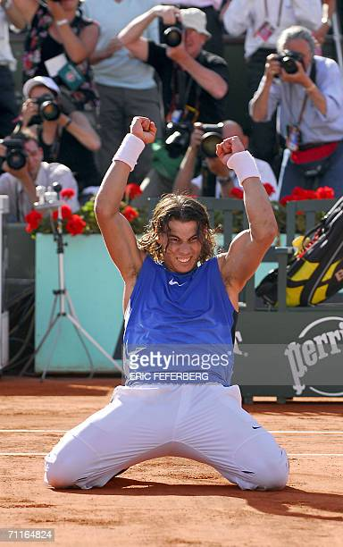 Spain's Rafael Nadal celebrates after defeating Croatia's Ivan Ljubicic during the semifinals of the French tennis Open at Roland Garros in Paris 09...