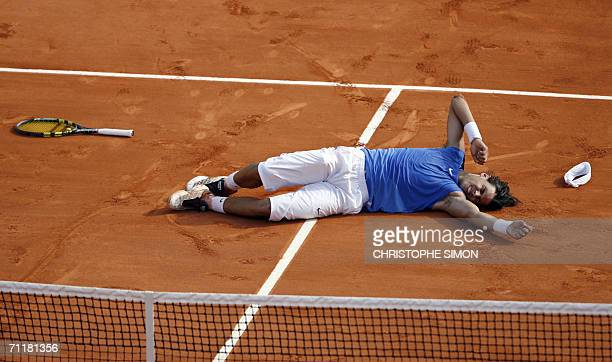 Spain's Rafael Nadal celebrates after defeating Swiss Roger Federer during the French tennis Open finals at Roland Garros in Paris 11 June 2006 AFP...