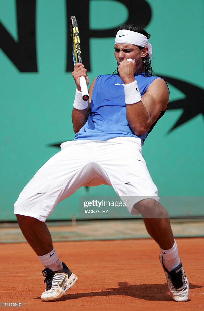 Spain's Rafael Nadal celebrates after winning a point to Swiss Roger Federer during the French tennis Open finals at Roland Garros in Paris 11 June 2006.
