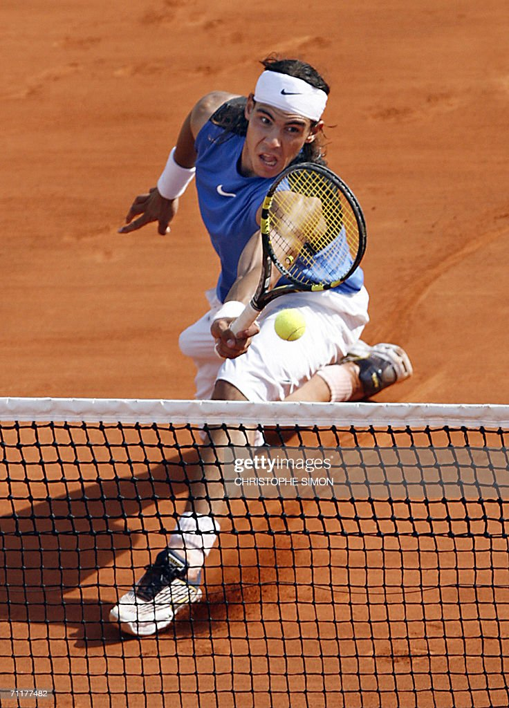 Spain's Rafael Nadal hits a shot to Swiss Roger Federer during the French tennis Open final at Roland Garros in Paris 11 June 2006.