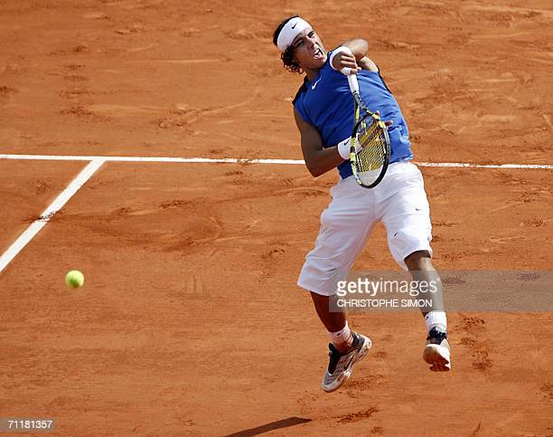 Spain's Rafael Nadal hits a shot to Swiss Roger Federer during the French tennis Open final at Roland Garros in Paris 11 June 2006 AFP PHOTO...