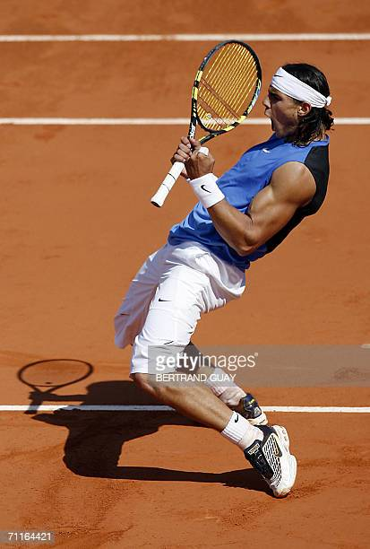 Spain's Rafael Nadal jubilates after winning a point against Croatian Ivan Ljubicic during the semifinals of the French tennis Open at Roland Garros...