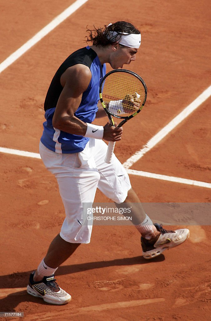 Spain's Rafael Nadal reacts after winning the third set against Swiss Roger Federer during the French tennis Open finals at Roland Garros in Paris 11 June 2006.