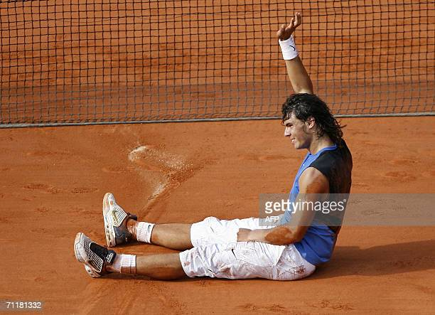 Spain's Rafael Nadal waves after winning the French tennis Open final against Swiss Roger Federer at Roland Garros in Paris 11 June 2006 Nadal won 16...