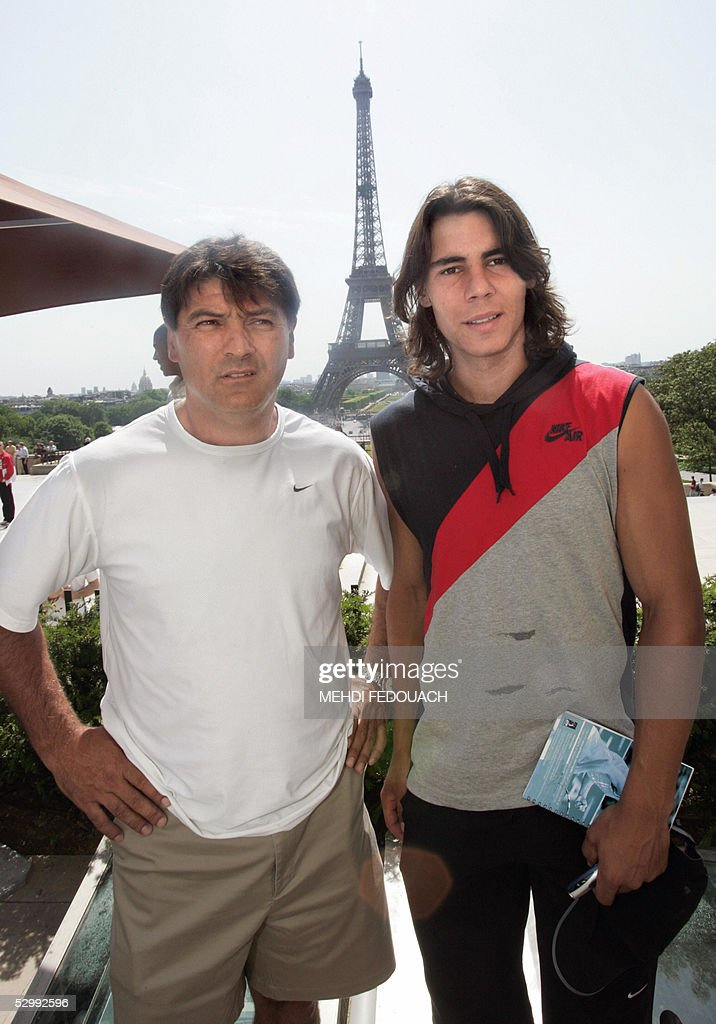 Spain's Rafael Nadal (R), who won the battle of the boy-wonders in the French Open yesterday despatching home hope Richard Gasquet of France, and his coach and uncle Toni Nadal pose during a press conference 28 May 2005 near the Eiffel Tower in Paris.