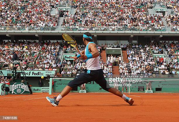 Spanish player Rafael Nadal hits a forehand shot to Australian player Lleyton Hewitt during their French Tennis Open fourth round match at Roland...