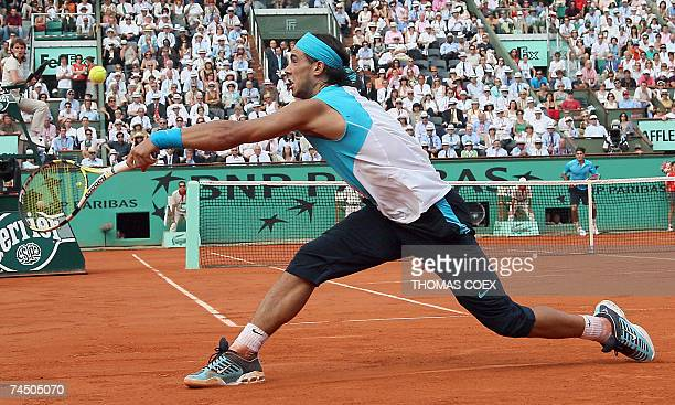 Spanish player Rafael Nadal hits a forehand shot to Swiss player Roger Federer during their French Tennis Open final match at Roland Garros 10 June...