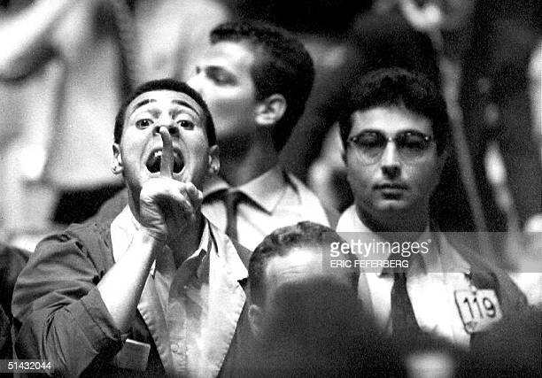 Paris France stock exchange employee gives an order at the Paris Bourse 21 September 1992 one day after the French approval of the Maastricht union...