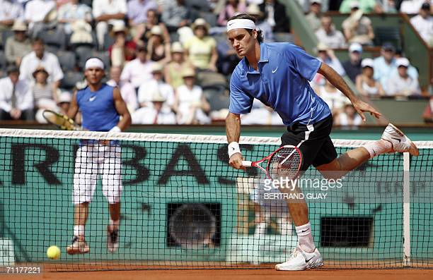 Swiss Roger Federer misses a shot to Spain's Rafael Nadal during the French tennis Open finals at Roland Garros in Paris 11 June 2006 AFP PHOTO...