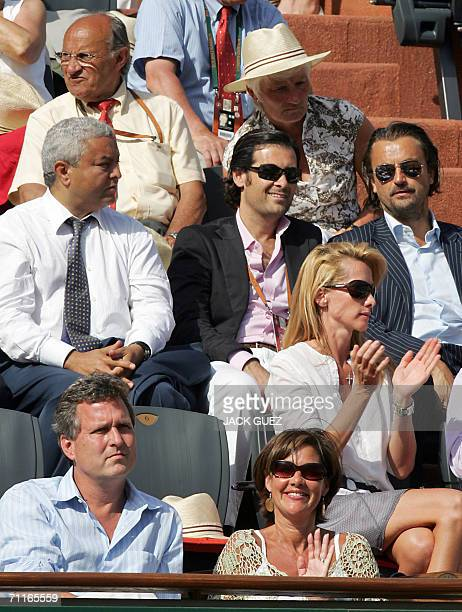 The brother of US President George W Bush Marvin Bush is seen in the stands with former French tennis player Henri Leconte during the match between...