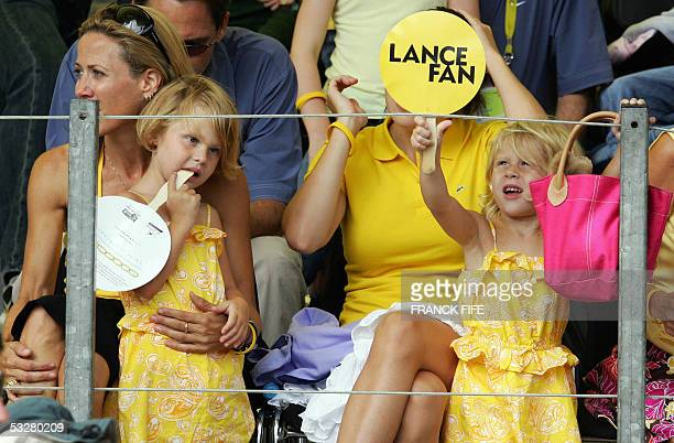 The girlfriend of US cyclist Lance Armstrong musician Sheryl Crow and his twin daughters Isabella and Grace cheer in the stands on the Champs Elysees...