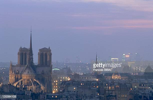 Paris France The NotreDame de Paris and La Defense in the background