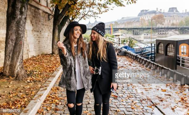 Paris, France, two women strolling near River Seine