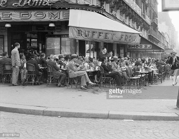 Typical French street scene People relaxing at the Cafe Le Dome popular outdoor cafe in Montparnesse Photograph 1930s