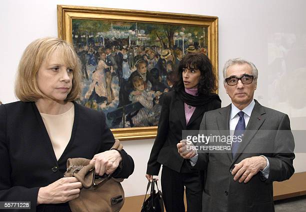 US director Martin Scorsese his wife Barbara De Fina and Sophie Renoir granddaughter of French director Jean Renoir stand in front of Auguste...